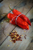 Dried red chilli peppers, flakes and seeds — Stock Photo