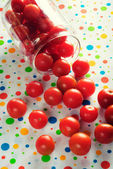 Scattered cherry tomatoes — Stock Photo