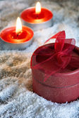Christmas gift and candles — Stok fotoğraf