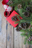 Pine branches,cones and gift and ribbon — Stock Photo