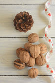 Walnuts, cone and ribbon — Stockfoto