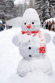 Snowman at Christmas fair with kiosk — Stock Photo