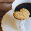 Stock Photo: Heart-shaped cookie and coffee