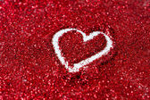 Heart shapes on glitter — Stock Photo