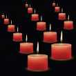 Red candles on black background — Stock Vector