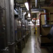 Handheld running through complex machine room — Stock Video