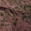 Stock Video: Aerial shot of Redrock Mountain biking Moab Utah