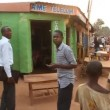 Stock Video: Walking through Africmarketplace with children