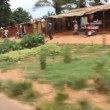 Driving through rural Congo pedestrians and bicyclists — 图库视频影像