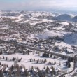 Stock Video: Aerial shot of sprawl, Park city Utah