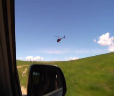 Driving next to a helicopter — Vídeo Stock