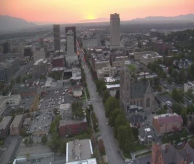 Aerial shot of downtown Salt Lake City, sunset, and Cathedral — Stock Video