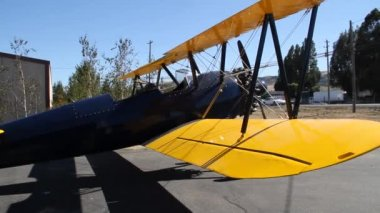 Stearman biplane taxis at airport — Stock Video