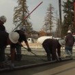 Crew smooths newly poured concrete — Stock Video