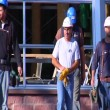 Construction workers walked toward camera slow motion — Stock Video