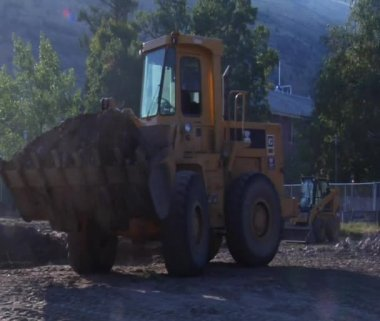 Front-end loader dumps dirt — Stock Video