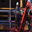 Man in Cherry Picker Crane descends — Stock Video