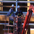 Two men in cherry picker crane — Stock Video