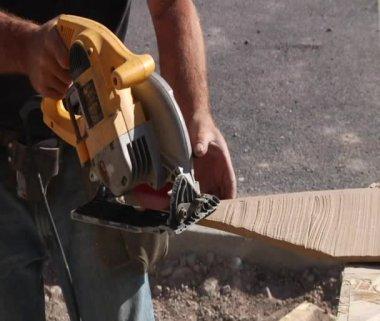 Close-up on circular saw cutting wood — Stock Video