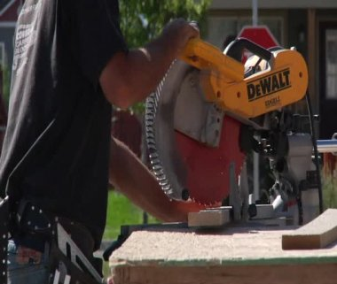 Man operates chop saw — Stock Video
