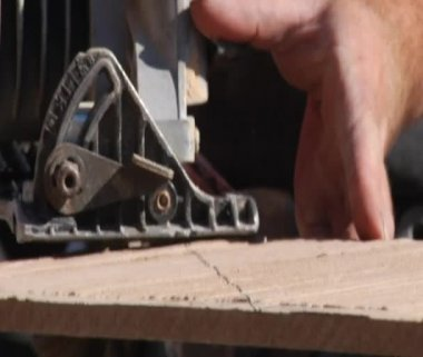 Close-up on saw cutting wood — Stock Video