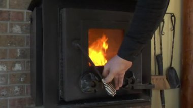 Closing and opening woodstove door with fire — Stock Video