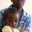Child on mother's lap in Haiti — Stock Video