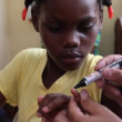 Child receives fingernail mark in Haiti — Stock Video