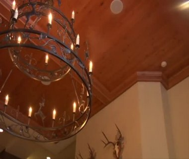 Iron chandelier in European hotel — Stock Video