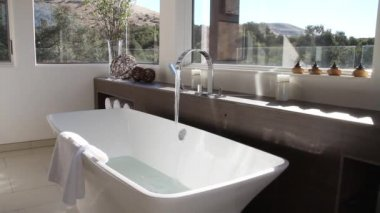 Luxurious modern bathroom with bathtub filling — ストックビデオ