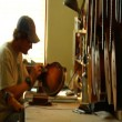 Worker sanding mandolin comes into focus — Stock Video #30377307