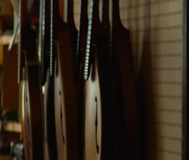 Shot of stringed instruments hanging on the wall — Stock Video