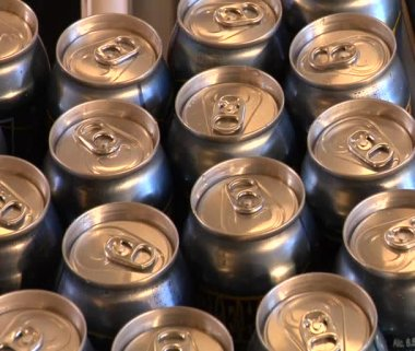Close-up of beer cans on the assembly line — Stock Video