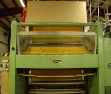 Spaghetti making machine cuts pasta — Stock Video
