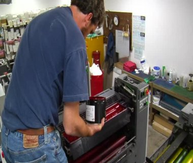Printing press technician adds red ink — Stock Video