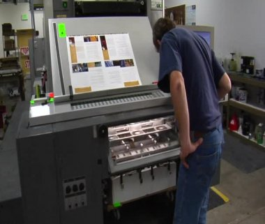 Man examines work from printing press — Stock Video