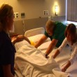 Nurses moving patient from one bed to another — Stock Video