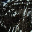 Stock Video: Craggy snow-covered mountain cliffs