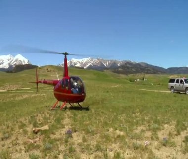 Robinson R 44 helicopter just landed — Stockvideo
