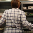 Woman opening industrial refridgerator — Stock Video