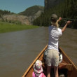 Woman flyfishing from driftboat on river — Stock Video
