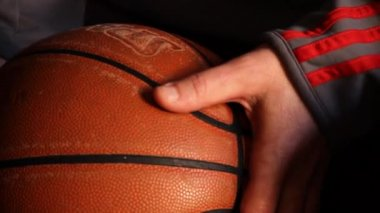Worn basketball in hands — Stock Video