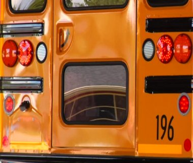 Reflections in rear of parked schoolbus — Stock Video