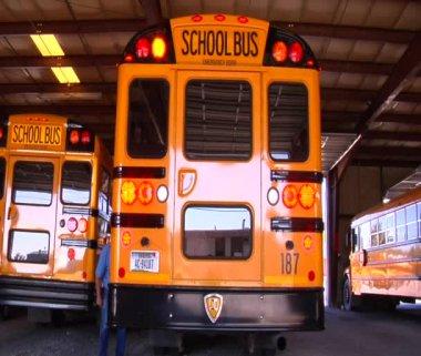 Man walking behind schoolbus — Stock Video
