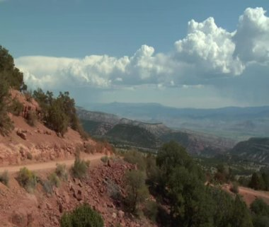Desert and mountain vista with ATV riders — Stock Video