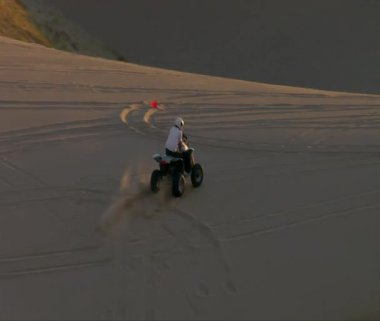 ATV rider on sand dune — Stock Video