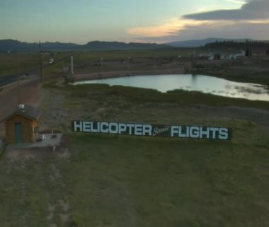 Aerial shot of scenic helicopter flights sign — Stock Video