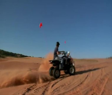ATV riders kick up sand — Stock Video