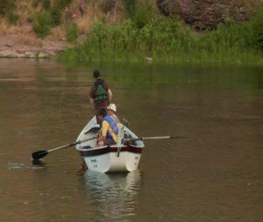 Flyfishing drift boat on calm water — Stock Video