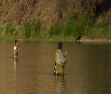 Father and son flyfishing in smooth River — Stock Video